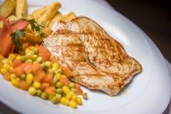 Lombo de carne de porco e prato lateral grelhados Imagem de Stock