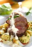 Lombo do forno com batatas Fotografia de Stock