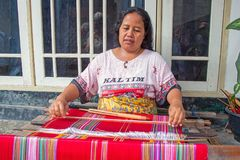 LOMBOK, INDONESIA - DECEMBER 30, 2016: Woman weaving on a loom i. N Lombok on 30th december 2016 Stock Image