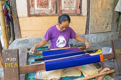 LOMBOK, INDONESIA - DECEMBER 30, 2016: Woman weaving on a loom. In Lombok on 30th december 2016 Royalty Free Stock Photos