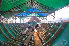 Workers building a boat in a traditional way on Gili Meno, Indonesia Royalty Free Stock Photography
