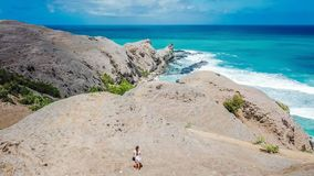 Lombok - Woman standing on the cliff stock photo