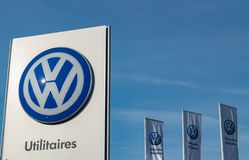 Volkswagen logo in the commercial vehicle showroom. Lomme,FRANCE-February 17,2019:Volkswagen is a German car manufacturing company since 1937.One of the largest stock images
