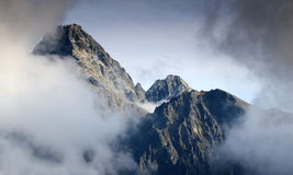 Lomnicky peak and Lomnicky ridge in clouds High Tatra Slovakia. Cloud covered Lomnicky peak, with observatory, and Lomnicky ridge  with Kezmarsky peak in the Stock Photography