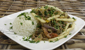 Lomo Saltado. A peruvian dish made with sautéed beef, tomatoes, onion, fried potatoes and rice Royalty Free Stock Images