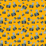 Lomography film camera on orange background. Vector seamless pattern Stock Photography