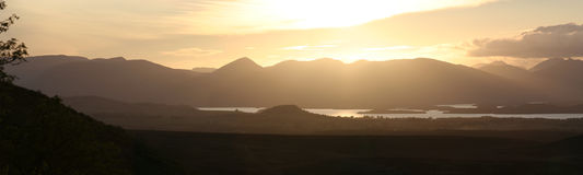 Lomond gold. The Luss Hills and Loch Lomond at sunset royalty free stock image