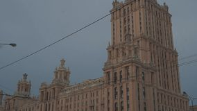 Lomonosov Moscow State University building in falling snow on winter day stock footage