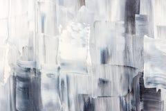 Lona artística con los movimientos blancos y negros del cepillo fotos de archivo