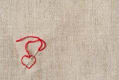 Lona con el corazón en abajo esquina izquierda Imagenes de archivo