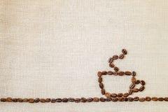 Lona de la harpillera de la arpillera y fondo de la foto de los granos de café copia Foto de archivo libre de regalías