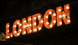 Londen verlichte affiche Stock Foto's