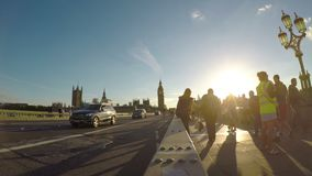 LONDON � JULY 2017: Busy tourists people and vehicles on Westminster Bridge on summer day at sunset -. LONDON � JULY 2017: Busy tourists people and vehicles stock video