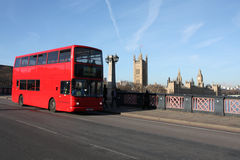 London. Red doubledecker bus, Victoria Tower, Houses of Parliament and Big Ben seen from Lambeth Bridge over river Thames in London, England Royalty Free Stock Photos