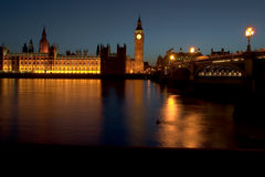 London. The famous landmarks of London: The Parliament, the Big Ben and the Thames by night stock images