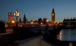 London. The famous landmarks of London: The Parliament, the Big Ben and the Thames by night Royalty Free Stock Photo