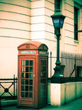 London. A shot of London that looks as if it was taken in the 70s with a phonebox and a police station Royalty Free Stock Photography