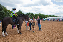 London 2012. Onlookers admiring police horses Stock Image