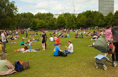 London 2012. Londoners and tourists use a hot day to relax in Hyde Park Stock Image