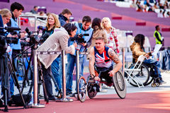 London 2012: athlete on wheelchair interviewed. Athlete at the Visa London Disability Athletics Challenge at the Olympic Stadium in London on May 8, 2012. The Stock Photos