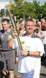 London 2012 Olympic Torch Bearer. An Olympic Torch bearer carrying the Olympic Flame Stock Photos
