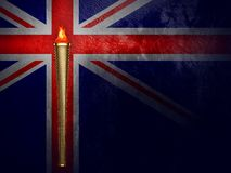 London 2012 Olympics Torch. Olympic torch and fire with united kingdom flag background Royalty Free Stock Photo