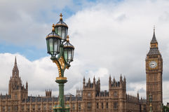London. Scene with a lamp in front of the Houses of Parliament Stock Images