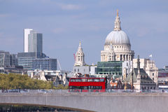London. United Kingdom - cityscape with famous St. Paul's Cathedral and a bridge with red doubledecker bus Royalty Free Stock Images