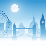 London. A Misty London Cityscape with Moon Royalty Free Stock Photo