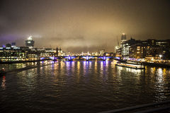 London. Bridges seen from boat on thames stock photos