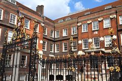 London. United Kingdom - famous College of Arms, Royal Corporation with roles in ceremonies, names and genealogy royalty free stock photo