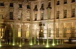 London. Fountains in the courtyard of somerset house at night, London stock photography