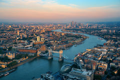 London aerial. London rooftop view panorama at sunset with urban architectures and Thames River