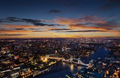 London aerial view with Tower Bridge in sunset. London aerial view with dominant of Tower Bridge in sunset light. Panoramic landscape with beautiful dramatic sky royalty free stock photography