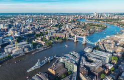 London aerial view with urban architectures and Tower Bridge. View to the skyline of London with tower bridge and business district at the thames river in london stock photography