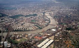 London from the air, looking East. London seen from the air while flying along the Thames Royalty Free Stock Image