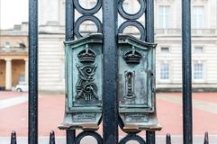 LONDON: Ancient lock on Buckingham Palace Gate - famous landmark in London, England. Built in 1705, Pala. Ce is official London residence and principal workplace Stock Photography