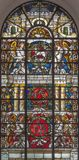 London - The angels with the IHS initials and Lamb of God on the stained glass in church St. Vedast alias Foster. LONDON, GREAT BRITAIN - SEPTEMBER 14, 2017: The Stock Photography
