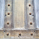 In london antique bro wn door  rusty  brass nail and light Stock Photos