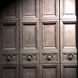 In london antique bro wn door  rusty  brass nail and light Stock Image