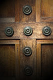 In london antique brown door  rusty  brass nail and light Stock Photography