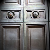 In london antique brown    door  rusty  brass nail and light Royalty Free Stock Photos