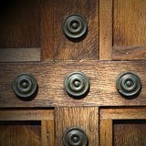 In london antique brown door  rusty  brass nail and light Royalty Free Stock Images
