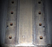 In london antique  door  rusty  brass nail and light Royalty Free Stock Photos