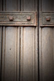 In london antique  door  rusty  brass nail and light Royalty Free Stock Image