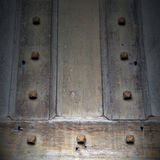 In london antique  door  rusty  brass nail and light Royalty Free Stock Photo
