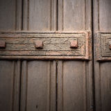 In london antique  door  rusty  brass nail and light Stock Photos