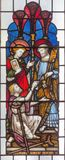 London - The apostles Peter and John heal of paralytic in front of Temple in Jerusalem on the stained glass in St Mary Abbot`s. LONDON, GREAT BRITAIN - SEPTEMBER stock image