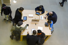 London Apple Store. The interior of an Apple store in London with shoppers sampling products Stock Photos