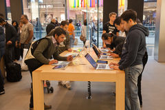 London Apple Store. The interior of an Apple store in London with shoppers sampling products Royalty Free Stock Photo